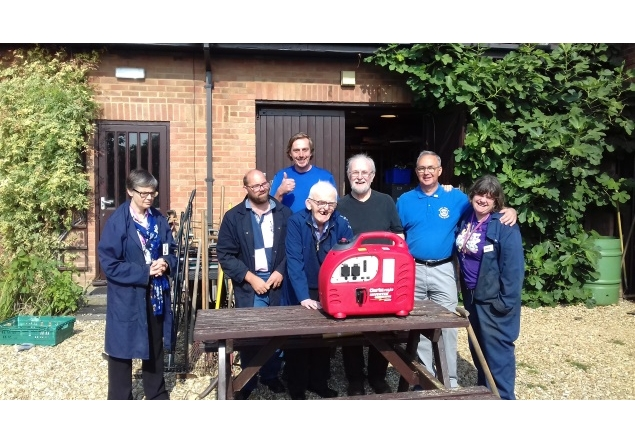 Barton-Le-Clay Rotary supports 'Tools for Self Reliance' in UK & Malawi - President David Swain, Tools for Self-Reliance Trustees and staff and the new generator.