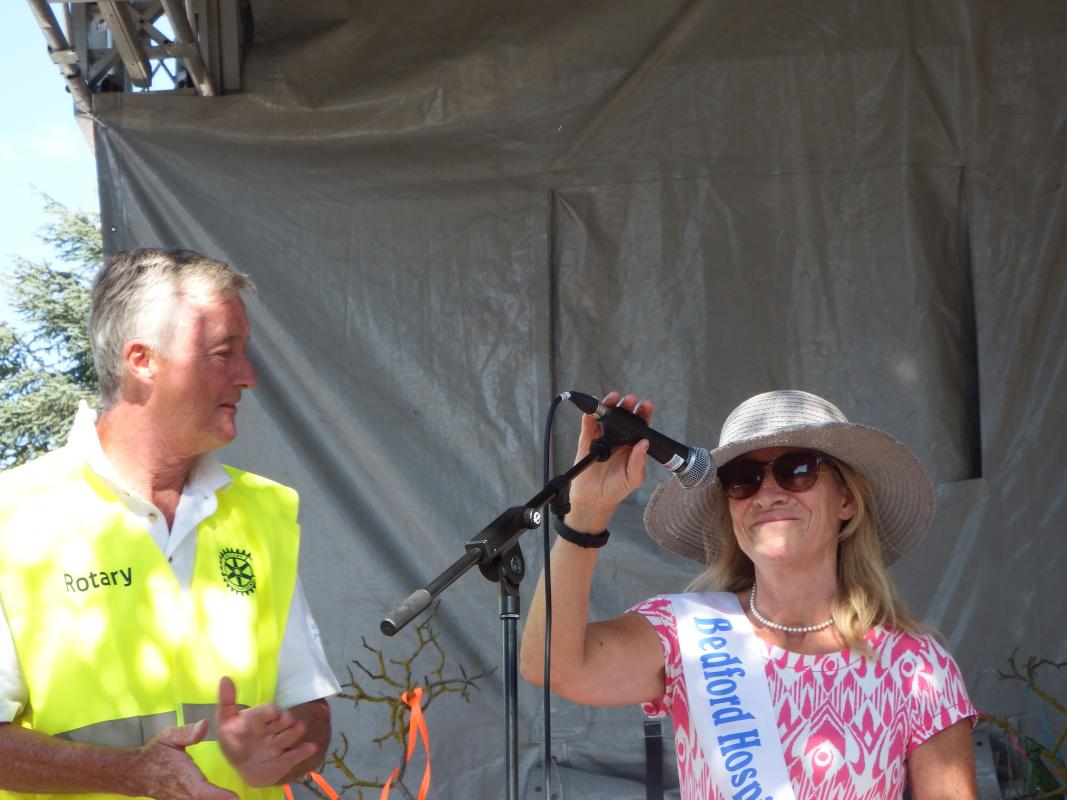 Bedford Park Raft Race - Rotarian William Naylor from the Rotary Club of Bedford Park introduces Debbie Inskip, Chairman of the Bedford Hospitals Charity during the prize presentation following the race.