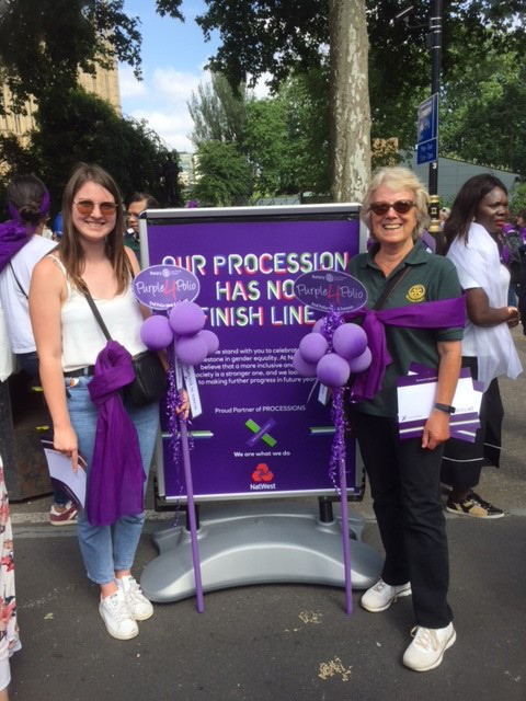 Women's 100 years of Suffrage March - Jasmine Morris with her granddaughter Elly at the Women's Suffrage march