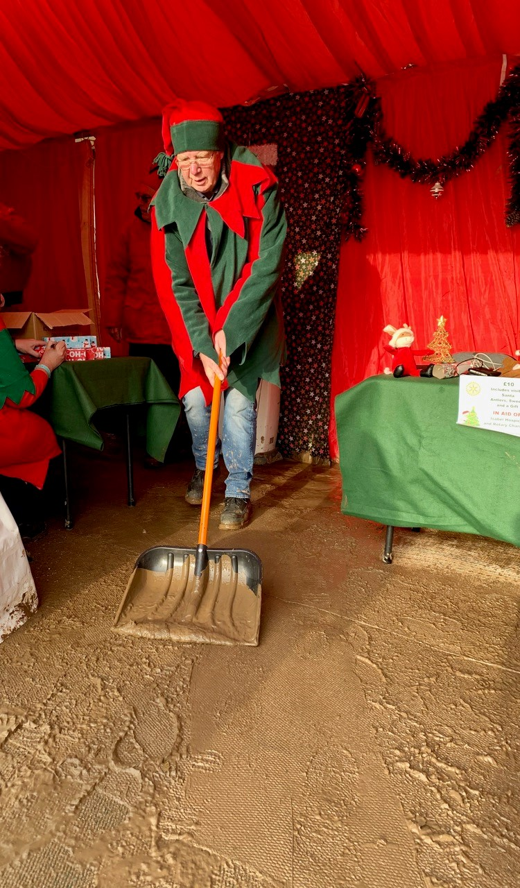 Hatfield at the Aldenham Country Park Frost Fair - Elf John getting some of the mud out of Santa's Grotto