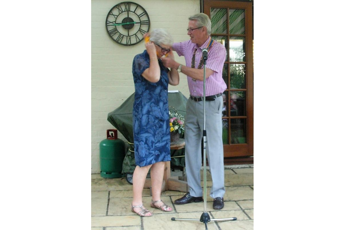 Letchworth Howard Handover and Presentations eveningclub's Handover and Presentations evening - Keeping it all in the family: Angela Silver receives her president-elect chain from her husband Tony, whom she will succeed next year as Letchworth Howard president.
