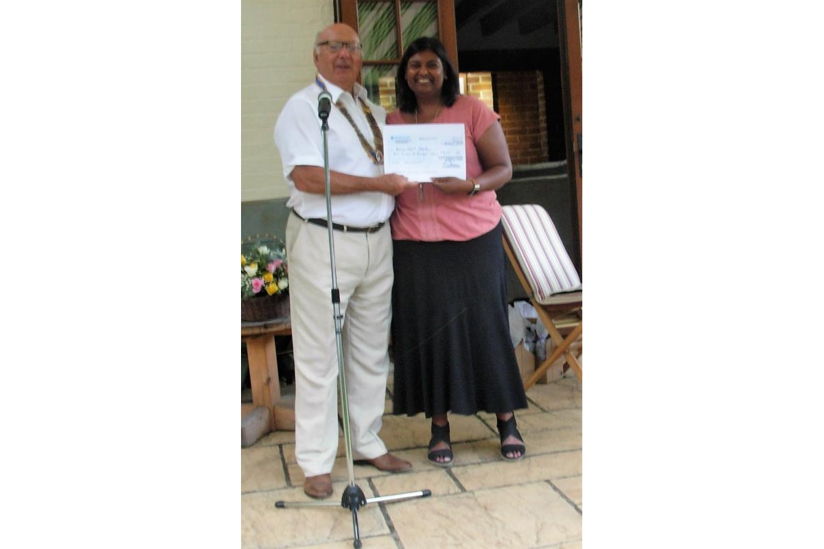 Letchworth Howard Handover and Presentations eveningclub's Handover and Presentations evening - Faith Hojeer, from Home Start Hertfordshire, is all smiles as she receives a cheque for £600 from Letchworth Howard fund-raising activities.