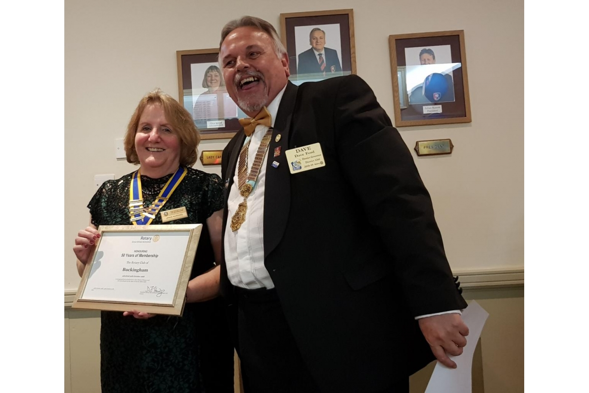 DG's Newsletter - November 2018 - President Janis Harding and DG Dave celebrating 50 years of Buckingham Rotary