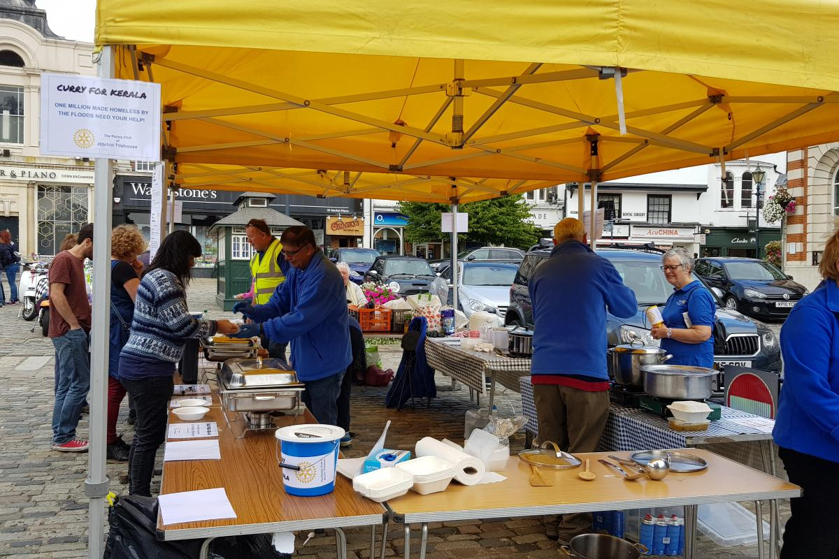 District Governor's Newsletter - October 2019 - Hitchin Tilehouse out in the Market Square selling their Currys for Kerala