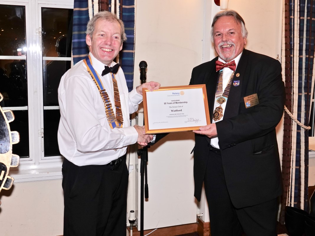 Watford Rotary Club Celebrates 95 Years Of Service - Dave presenting Tim with certificate of honour