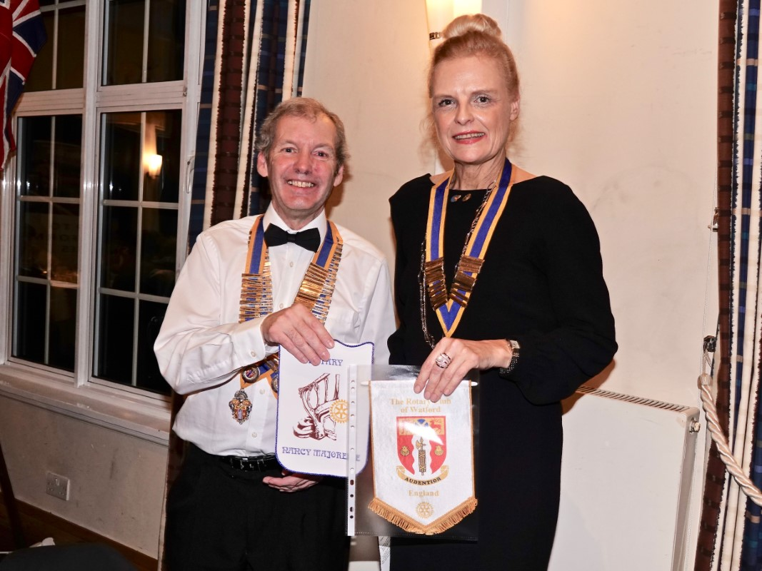 Watford Rotary Club Celebrates 95 Years Of Service - Exchanging pennants
