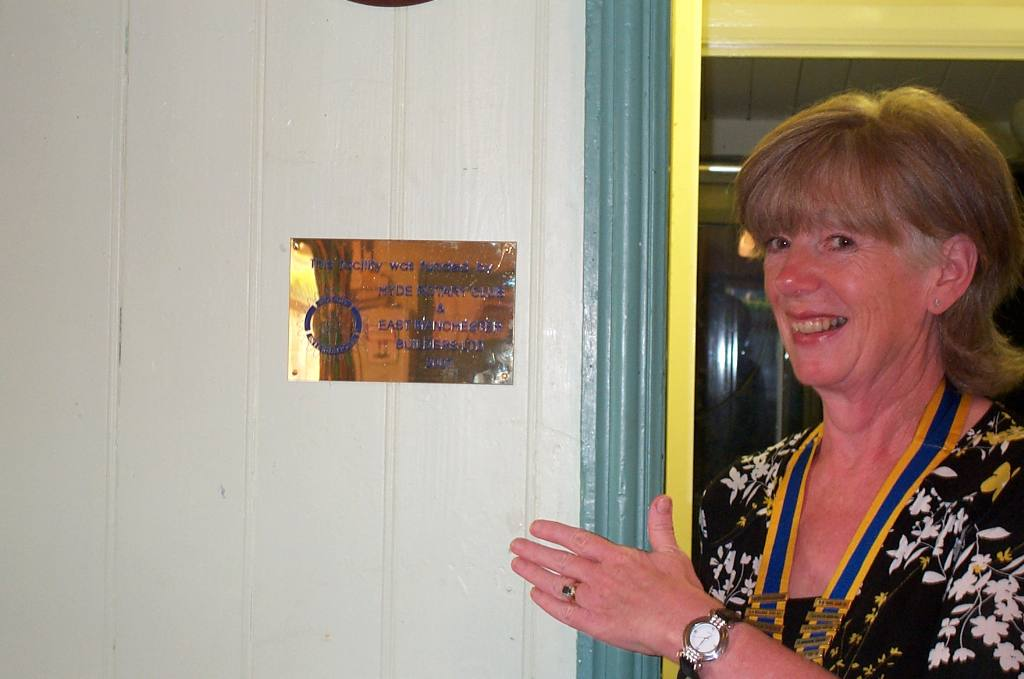 St Albans Project - President Mavis showing Rotary plaque regarding the new facilities