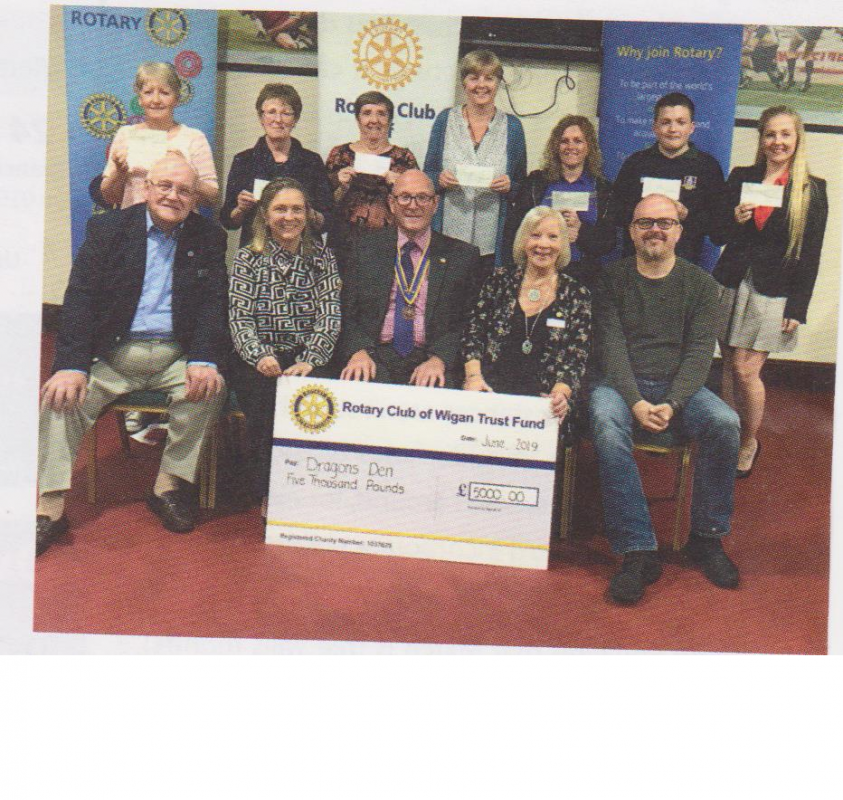 Dragon Den is postponed - The Dragons, Rtn Mervyn Reeves,  Jane Dennis from Fairhurst Accountants, Wigan Rotary President John Wright, Rtn. Aukje Clegg OBE, and Chris Pearce from Local Life and with the representatives of the winning teams standing behind.