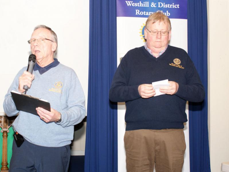 Rotary Primary Schools Fun Quizs P4 to P7 - President John checks Russell is adhering to the script