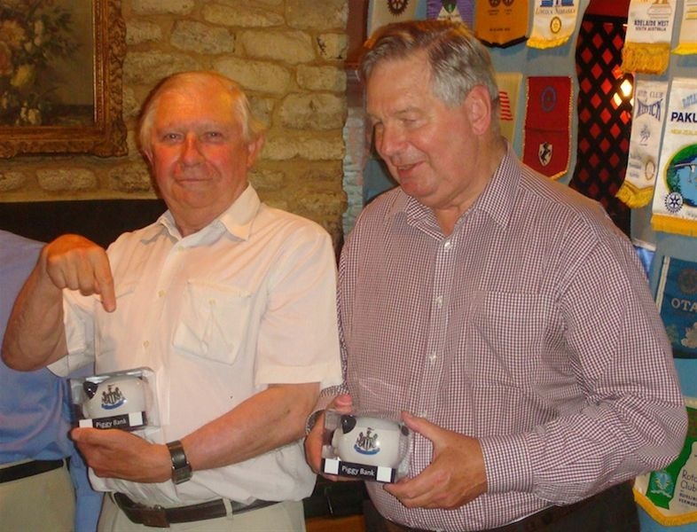 David Harding & Bill Carss hang up their collection tins after 25 years service in the Woodstock Rotary Club -