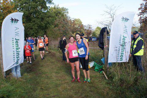 Trail Run 2014 - Happy runners at the finish with sponsors flags