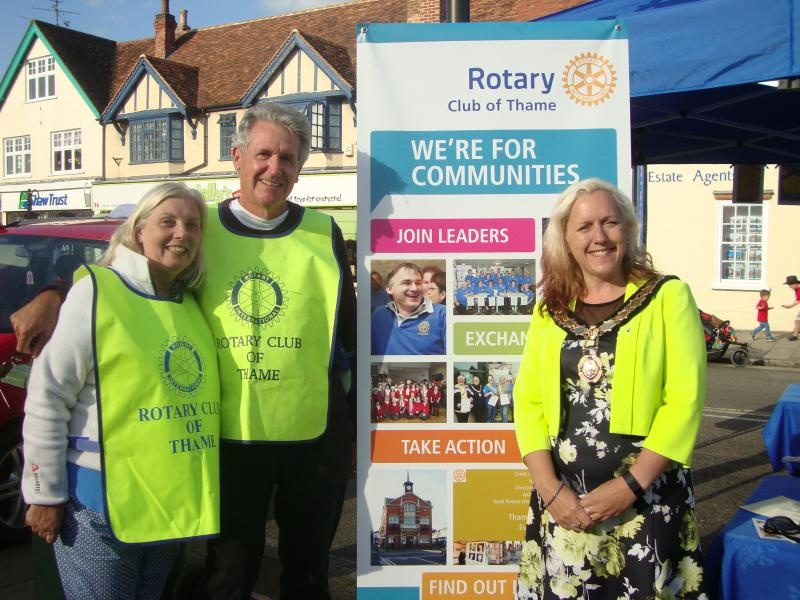 Thame Rotary at Thame Food Festival - just before pulling the winning raffle ticket