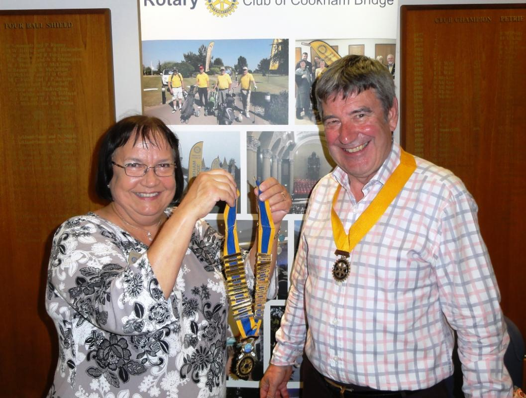 Organisation of Cookham Bridge Rotary Club - President Diana Phipps (2009-2010)prepares to handover to incoming president Chris Vance