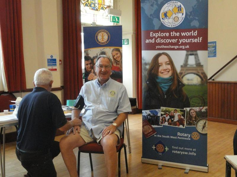 ROTARY TEA PARTY - A volunteer for the blood pressure test
