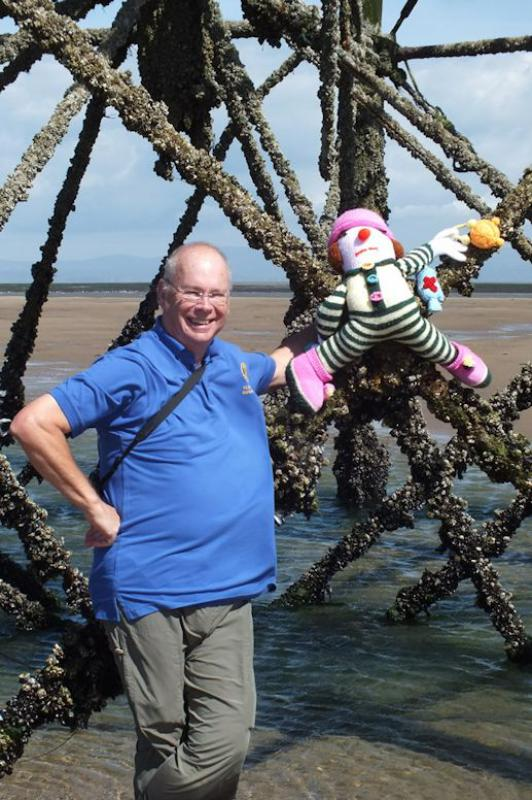 Photo Album - July/August 2014 - As part fo the Fleetwood Scarecrow festival, President Robert places our scarecrow on the Wyre Light