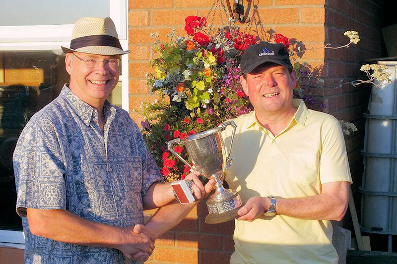 Photo Album - July/August 2014 - President Robert presents the winner's trophy to John Tripp who holds the title for the umteenth year!