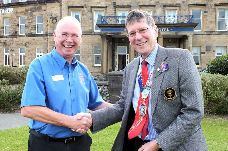 Photo Album - July/August 2014 - D1190 Governor, Roger Mason received the usual hearty welcome from President Robert.