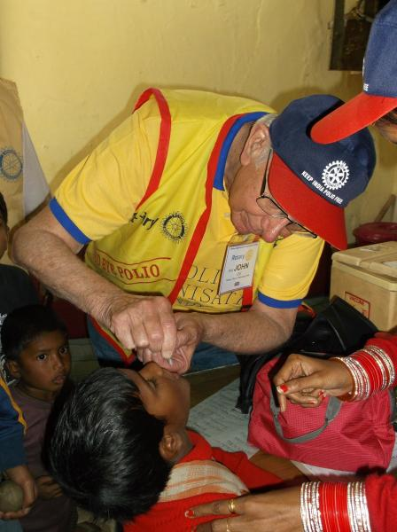 February 2016 Polio National Immunisation Day/August update  - Rtn. John giving drops to a child in Delhi Feb. 2016