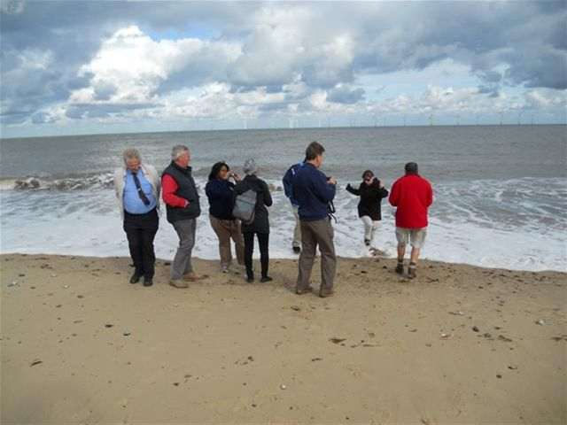 USA Group Study Exchange Team's visit to Norwich - Some of the team get caught with the incoming tide on Scrobi Sands in front of the wind farms.