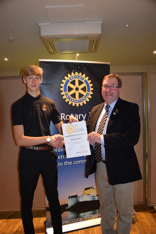 Public  Community Page - President James Campbell presents Rotary Youth Leader Award certificate to James Douglas