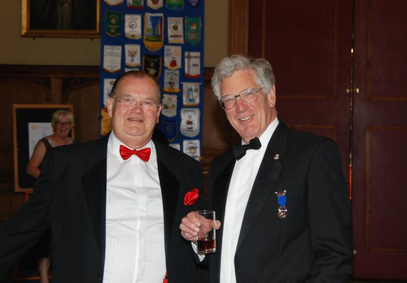 TRINITY GETS TO SILVER - PP Adrian Parker with Past Founder Member Malcolm Brown