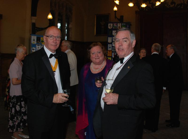 TRINITY GETS TO SILVER - Jim Milne with visiting Rotarian Tim Thomas and wife Liz