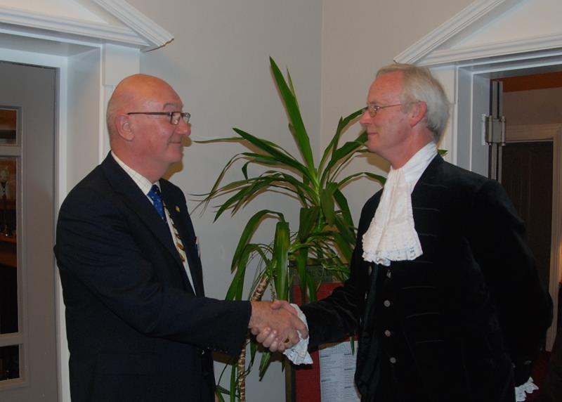 Trinity up before the Sheriff - President welcoming the High Sheriff)