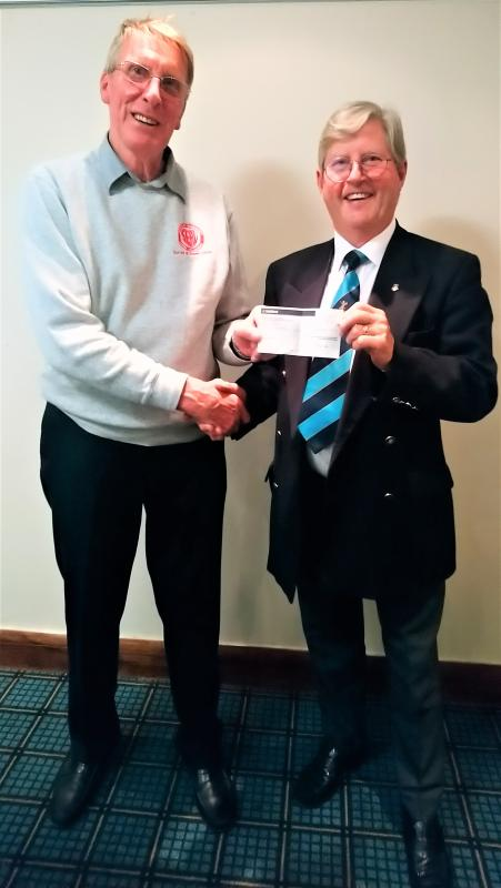 Cheques Presentation Evening 2019 - Smiles all round, as Hugh receives his cheque from Trevor!