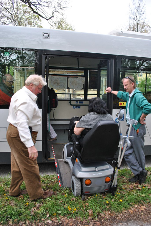 Berlin jaunt April 2012 - Pat and Kevin manouvering the motorised chair off the bus in Potsdam