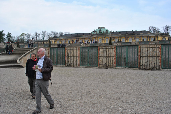 Berlin jaunt April 2012 - Ivan and Kim with the peach houses in the wall.
