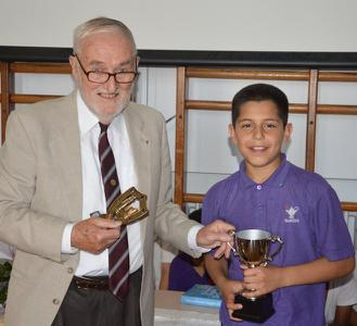 Chess at Heathfield Junior School - Rotarian Ken Smith presents the 2015 cup