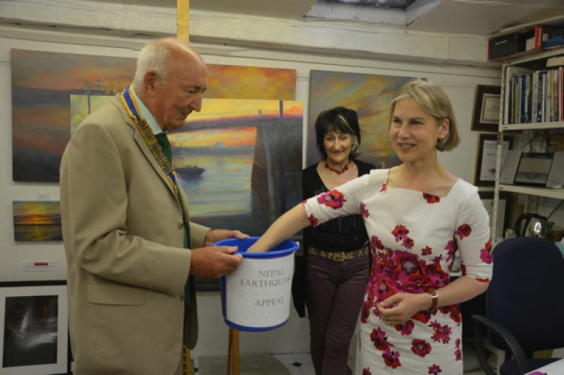 Local artist raffles for Nepal - Twickenham MP Dr Tania Mathias, draws the winning ticket