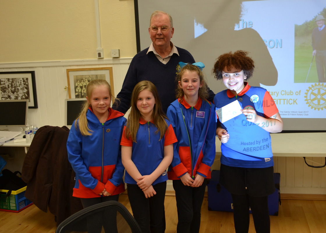 The Sandy Wilson Quiz - The youngest team participating receive their cheque from St Fittick President, Alan Oswald