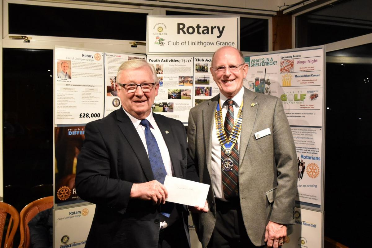 Presentations to local good causes - March 2019 - President Iain Keter presenting a cheque to Tom Kerr representing Linlithgow Link.