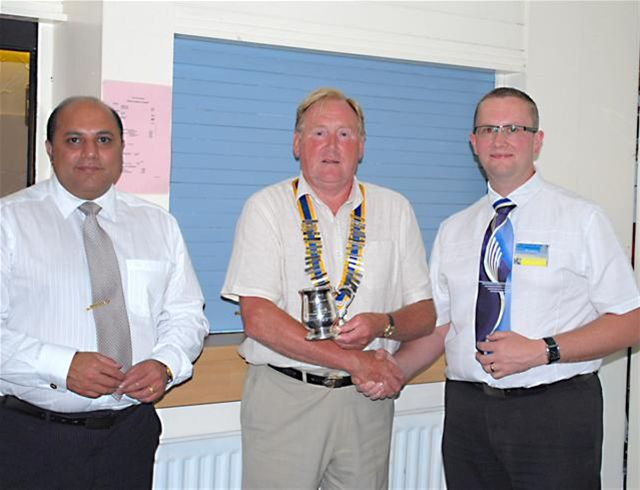 2010-11 Handover Pictures - Immediate Past President Dick Taylor congratulates his Rotarians of the Year, Warren Offer and Manoj Kundra