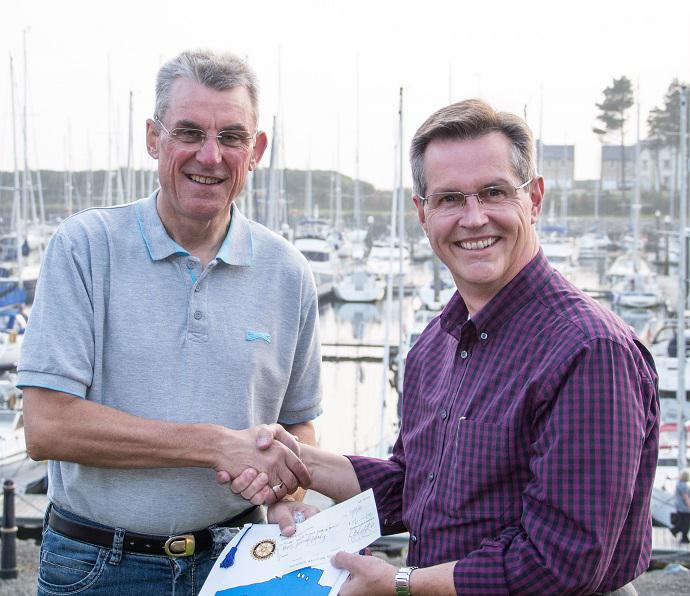 David Attwood's cycle ride  - President Alex Murphy presents a cheque to David on behalf of Gourock Rotary.