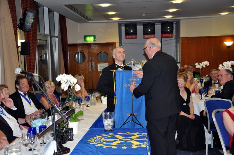 District 1040 Handover June 2012 - David accepting the DG flag to Birstall Luddites
