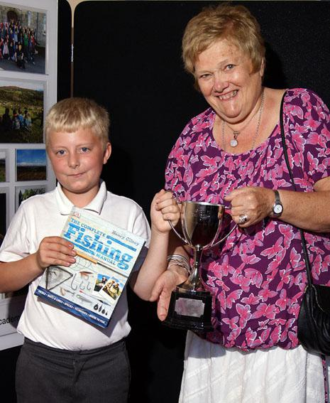 Torquay Rotary in school - The first recipient of the John Dewis Rotary Memorial Cup was David Leese, who is pictured with past president Linda Dewis.