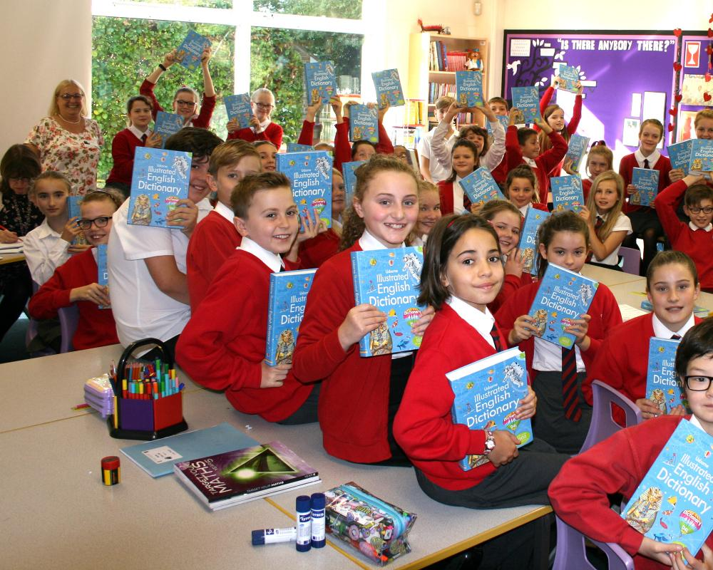 HOW DO WE DO OUR BUSINESS? - Presentation of Dictionaries to local school children