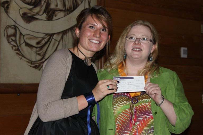 Oxford Rotaract Club receives its Charter - Sarah Field receives cheque from sponsoring club Oxford Spires President Elect Naomi Barnes