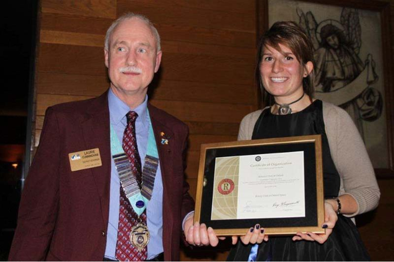 Oxford Rotaract Club receives its Charter - President Sarah receives the Charter from DG Laurie
