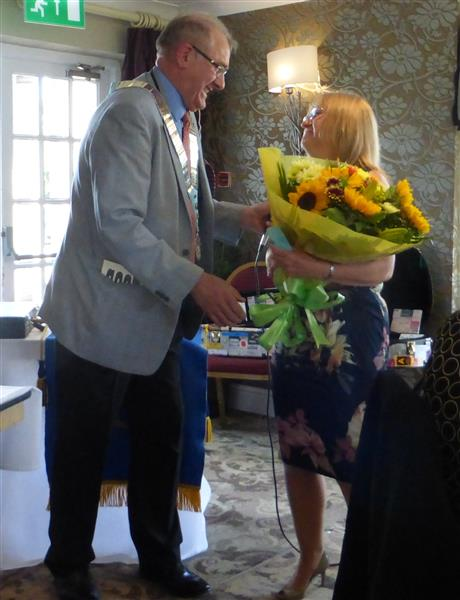 District Handover 2016 - Phil presents his wife, Judith, with boouqet of flowers