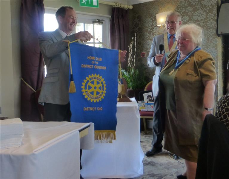 District Handover 2016 - Hazel presents DG Home Club banner to Chris Redfearn