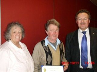 PHF Award to Eddie Allen - President Richard Corkill with former Rotarian Eddie Allen and his wife Ruth