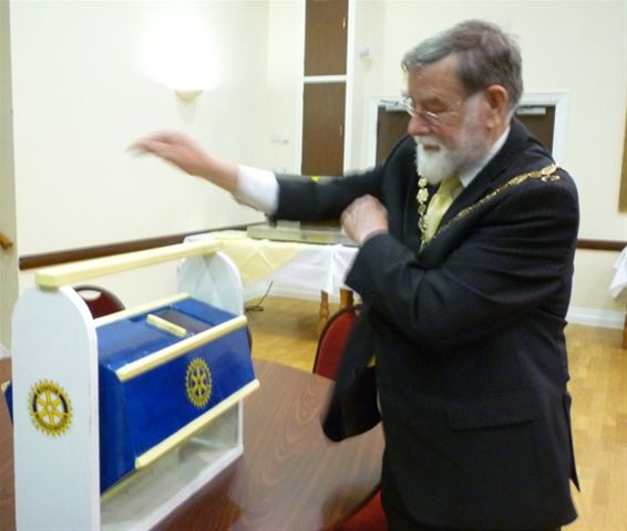 The Mayor makes The 2011 Easter Draw - The Mayor of Seaford selects the winning Easter Draw ticket from the raffle tub,