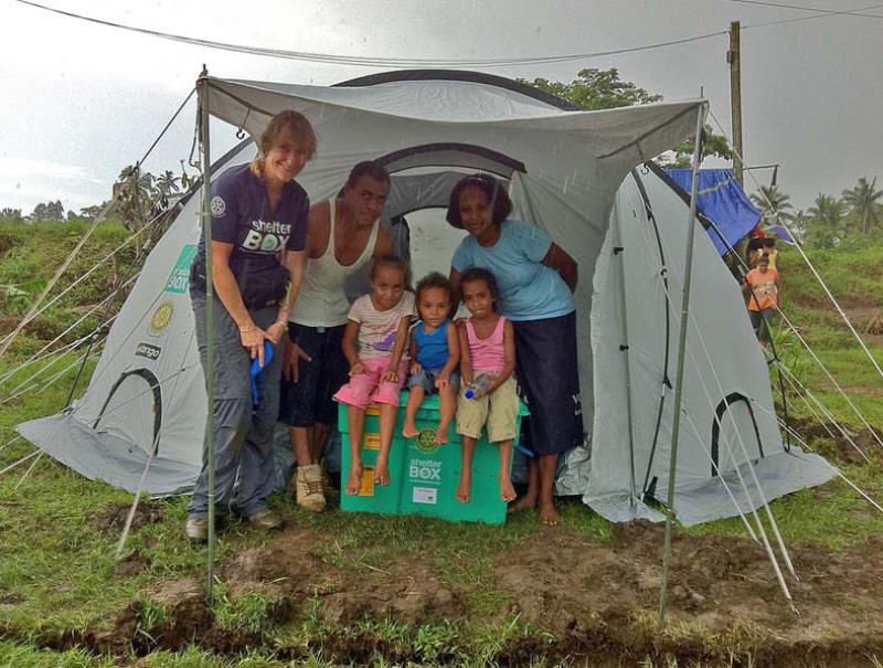 ShelterBox Disaster Response - A family is dry and warm in their new ShelterBox home