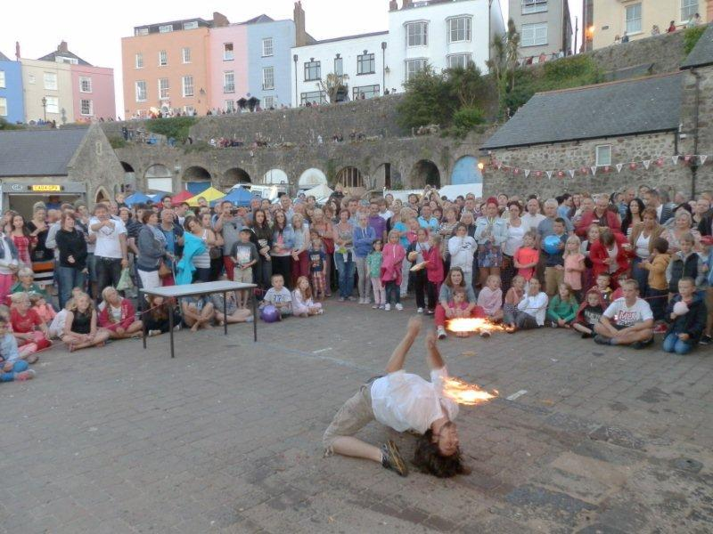 Family Fun Harbour Spectacular 2013 - Fire Juggler Marcus gets down low!