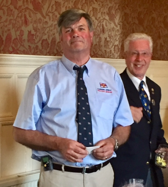 We need a bigger boat...! - Captain Marcus Elliott receives a £500 donation to RNLI Llandudno from Club President Mike Clutton