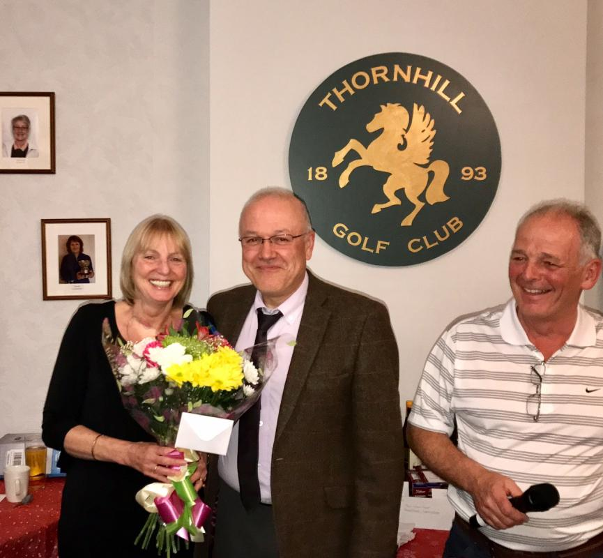 Annual Am/Am Golf Competition 2017 - President Trevor Baxter presents a of bouquet flowers to President Elect Liz Baxter whilst compare Gordon Lawson