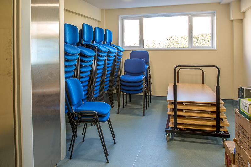 Ready for the Members to Return - Modern tables and stacking chairs ready for use.